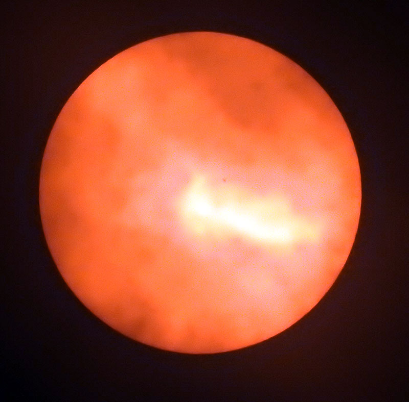 Sunspot on sun obscured by clouds